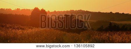 Orange sunset near village Tisa in north Bohemia summer