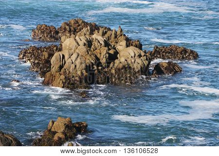 This is an image of rocks just off the coast of Pacific Grove, California, U.S.A.