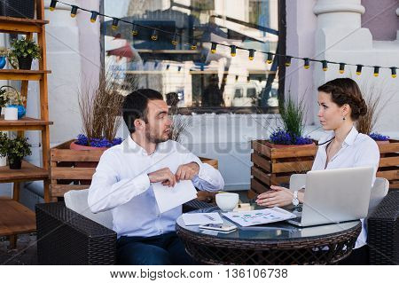 business people conflict working problem, angry boss argue scream to colleague businessmen and women serious argument negative emotion discussing report meeting at outdoors cafe during the lunch.