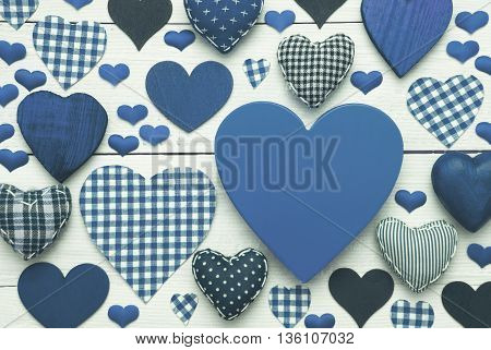Blue Heart Texture With Copy Space For Advertisement Or Free Text. White Wooden Background. Textile Hearts Which Are Dotted and Striped. Greeting Card For Congratulations Or Valentines Day