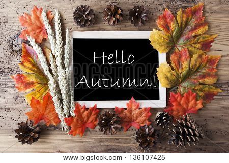 Blackboard With Autumn Or Fall Decoration. Greeting Card For Seasons Greetings. Colorful Leaves, Fir Cone And Barley On Aged Wooden Background. English Text Hello Autumn