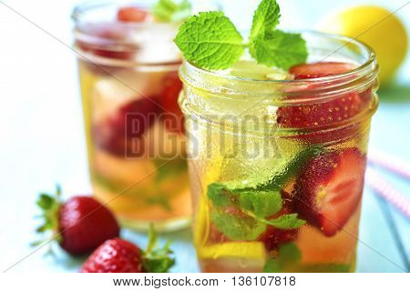Strawberry Lemonade With Lemon And Mint In A Mason Jar.