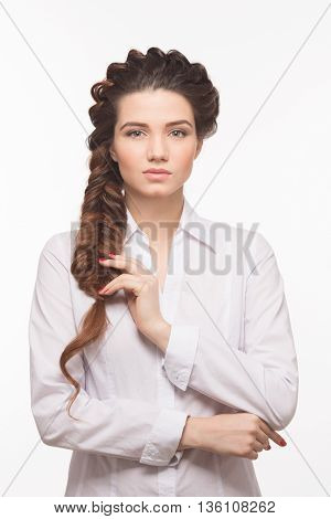 Hair braid. Beautiful woman with healthy long hair. Hairdressing. Hairstyle. Beauty glamour fashion model girl portrait. Perfect skin and makeup.