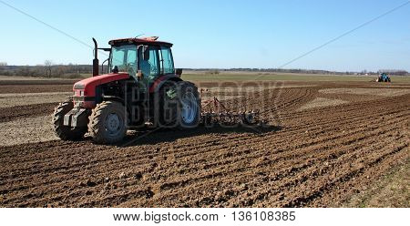 soil cultivation by mechanical means on the tractor for sowing