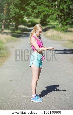 Young Girl Running In The Morning In City Park. Healthy Fitness Woman Jogging Outdoors.