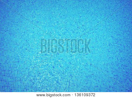 beautiful clear blue water in swimming pool mosaic bottom, retro toned