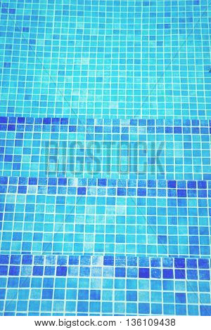 beautiful cool water in swimming pool mosaic bottom, retro toned