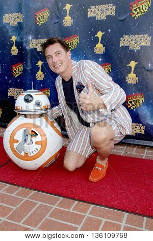 John Barrowman and an unidentified cosplayer arrive at the 42nd Annual Saturn Awards on Wednesday, June 22, 2016 at the Castaway Restaurant in Burbank, CA.