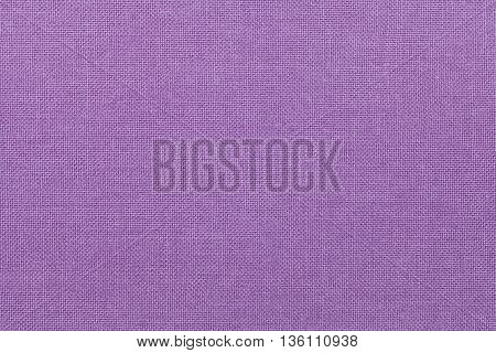 light purple background from a textile material. Fabric with natural texture. Cloth backdrop.