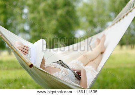 Caucasian Woman Relaxing In Hammock.