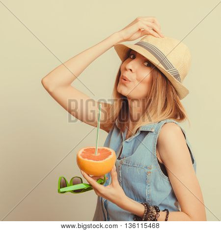 Happy glad woman tourist in straw hat drinking grapefruit juice and holding sunglasses. Healthy diet food. Weight loss. Summer vacation holidays. Instagram filtered.