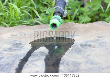 the water rust pipe with crystal-clear liquid