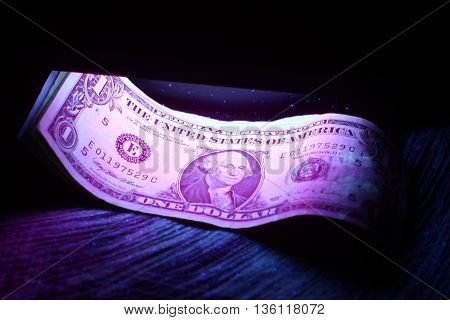 check on the authenticity of dollar notes