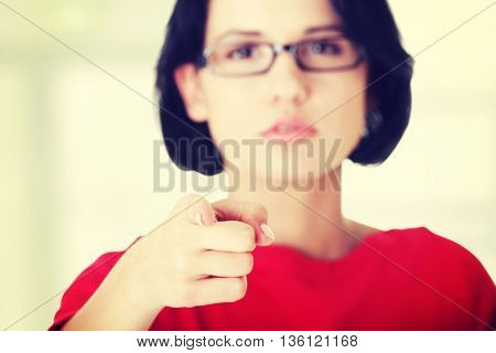 Woman pointing on you