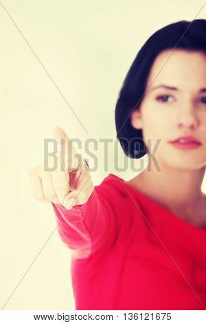 Young beautiful woman making choose