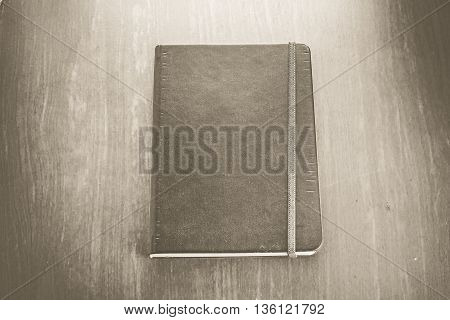 Vintage Sepia Color : Old Hardcover Notebook With Strip On Wood Table