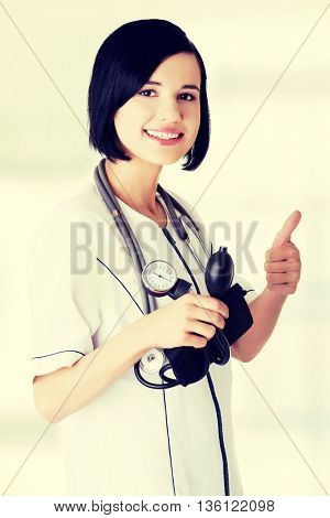 Woman doctor with blood pressure gauge