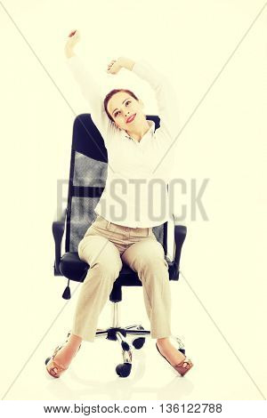 Beautiful business woman sitting and relaxing on a chair.