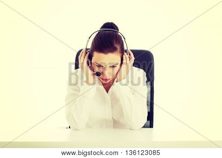 Beautiful woman sitting with microphone and headphones.