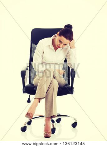 Beautiful sand business woman sitting on a chair.