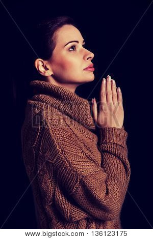 Young woman praying.