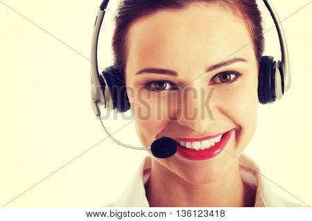 Beautiful woman standing with microphone and headphones.