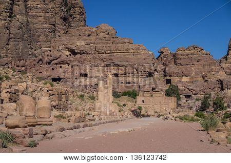 The Hadrian Gate and the Cardo Maximus in Petra. Qasr al-Bint at background. Petra Jordan