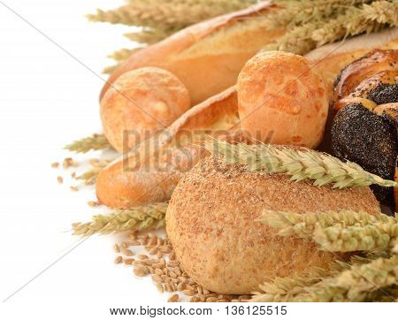 Bread and wheat on the white background