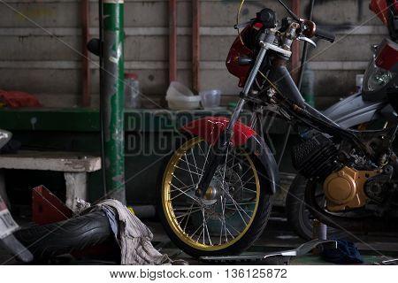 Details of Motorbike in repair garage, repair shop