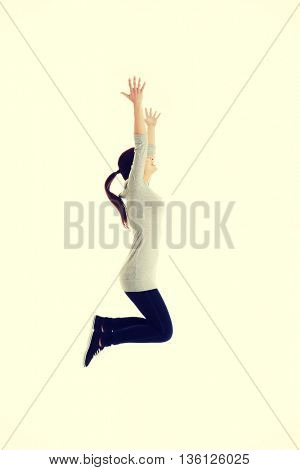 Casual woman jumping.