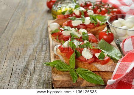 Italian bruschetta with mozzarella tomatoes and basil