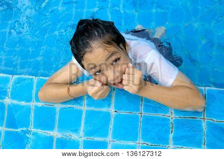 young girl alone  in swimming pool .