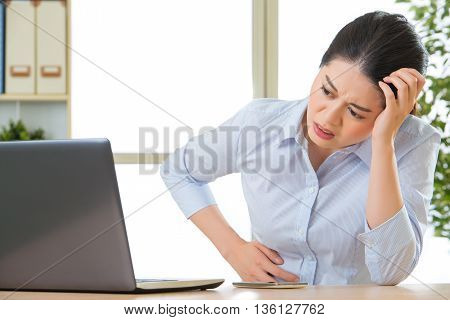 Young Asian Business Woman With Stomachache