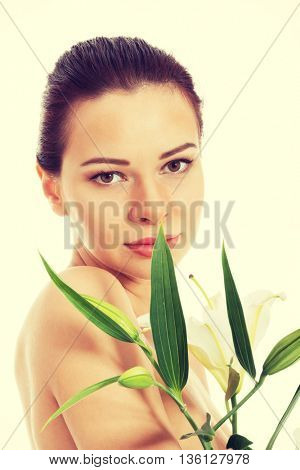 Beautiful topless woman with white lily.