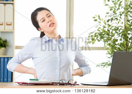 Young Asian Businesswoman With Pain In Back