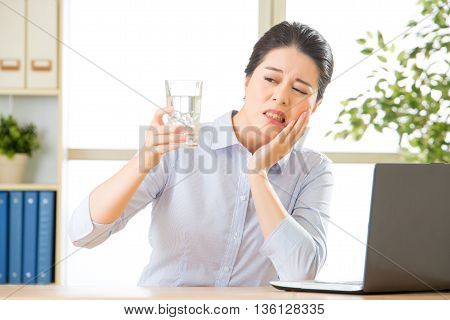 Young Asian Business Woman With Tooth Sensitivity