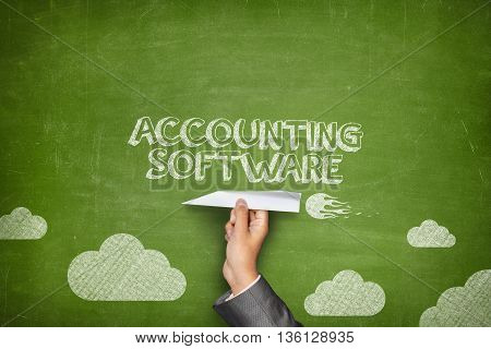 Accounting concept on blackboard with businessman hand holding paper plane