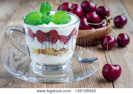 Cherry muesli and yogurt dessert in glass cherry verrine horizontal