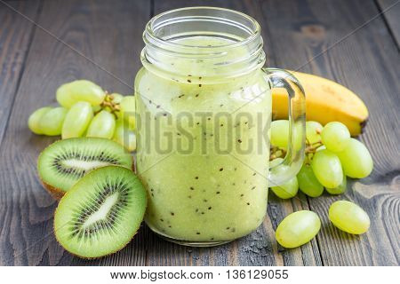 Healthy smoothie with kiwi green grape and banana in glass jar horizontal