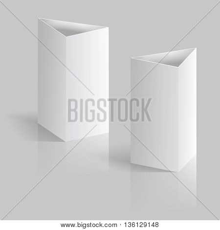 White blank table tent vertical triangle cards isolated on gray background with reflection vector mockup. Realistic mockup for booklet or brochure, illustration cardboard mock up for calendar