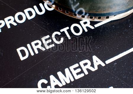 Director Label On Movie Clapper Board And Film Reel