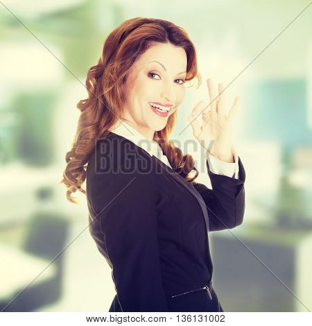 Business woman with perfect gesture