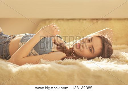 sensual girl lying looking at camera toned image with copyspace