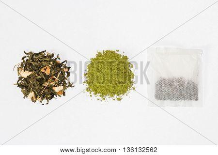 closeup of green tea, matcha tea and tea bag