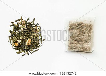 closeup of loose green tea and teabag