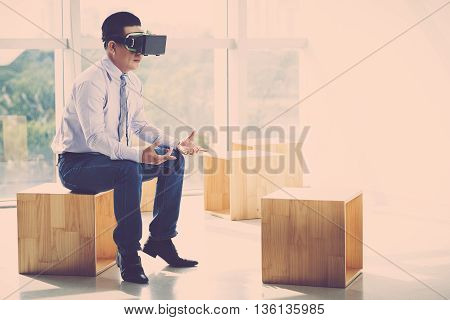 Businessman in VR headset having meeting with invisible partner