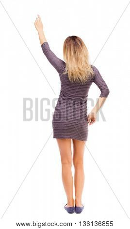 Back view of  pointing woman. beautiful girl. Rear view people collection.  backside view of person.  Isolated over white background. The girl in the purple dress raised her hand up.
