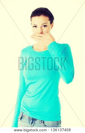 beautiful casual woman covering her mouth.