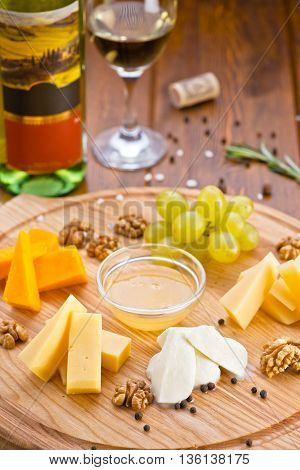 cheese with white wine green grapes walnuts different cheeses parmigiano mozzarella olive oil  gourmet