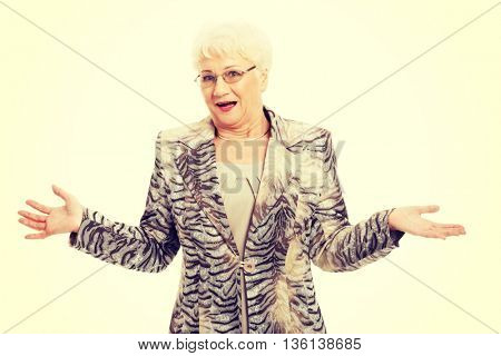 An old elegant lady having her hands spread.